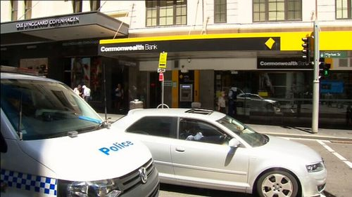 A man armed with a knife is on the run after attempting to rob a Sydney CBD Commonwealth Bank. (9NEWS)