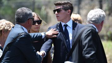 Sean Abbott is comforted as he arrives at the service. (Getty Images)