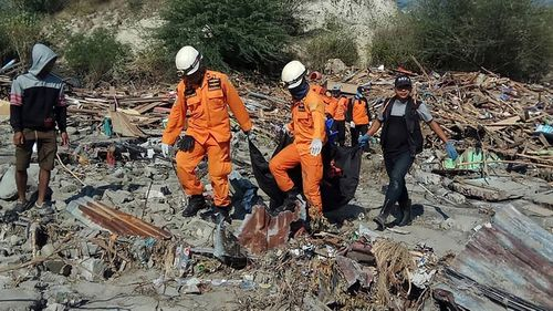 Following the Indonesian earthquake and tsunami rescuers are combing the wreckage for bodies.