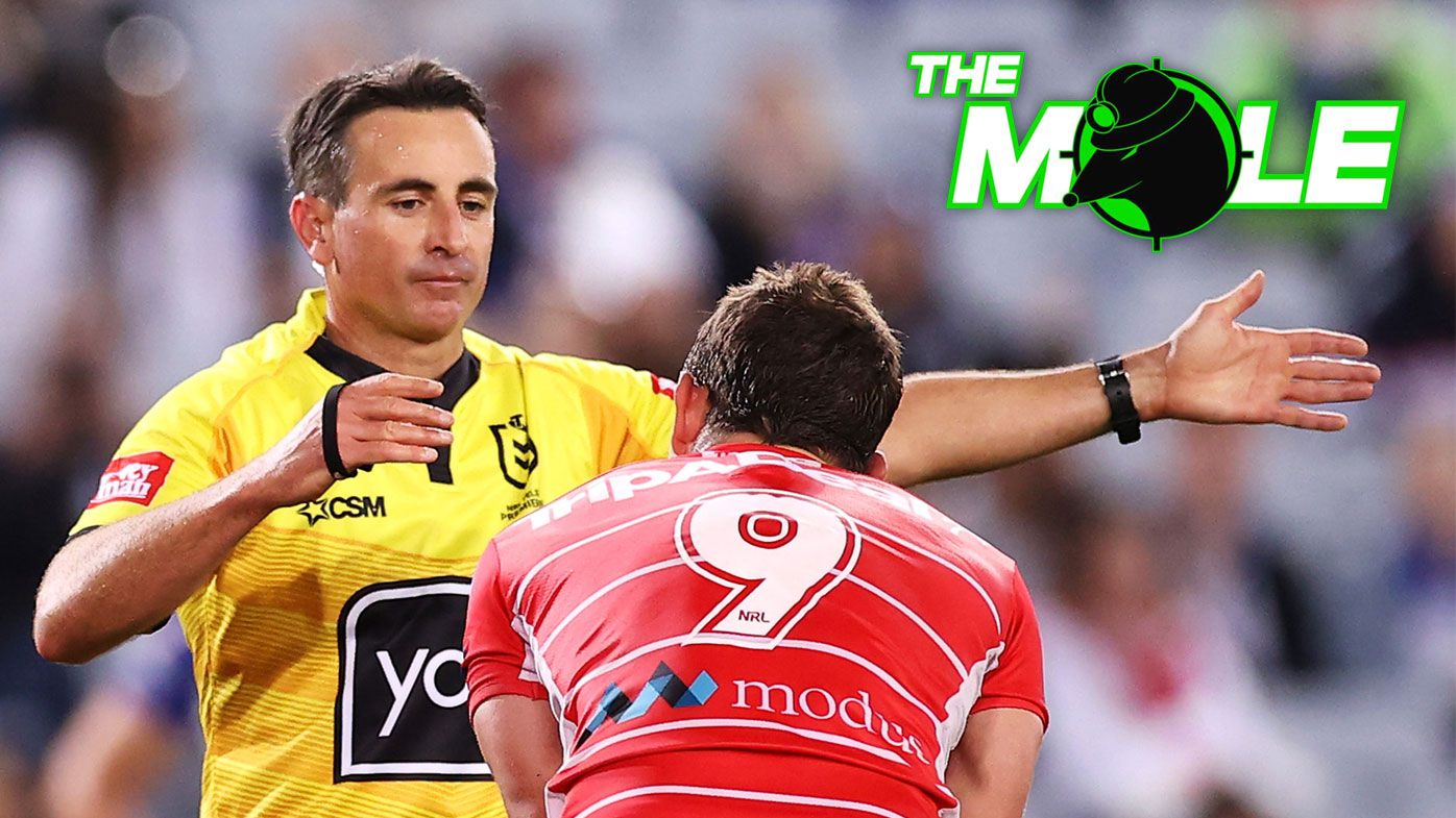 Referee Gerard Sutton speaks to Andrew McCullough of the Dragons.