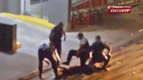 A member of the public filmed the four officers repeatedly hitting the 16-year-old. The exclusive footage was first aired on A Current Affair. (ACA)