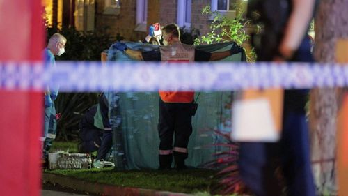 Police at the scene in Erskineville last night.