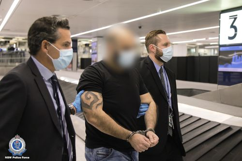 The pair landed at Sydney International Airport last night escorted by detectives.