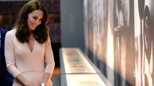 The Duchess of Cambridge then viewed portraits of herself, which were taken for Vogue. (Twitter / @KensingtonRoyal)