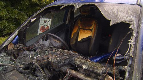 Flames engulfed the blue hatchback. Picture: 9NEWS
