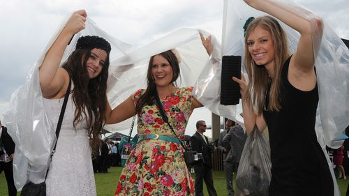 Punters don't usually let rain get in the way for a good day at the races.