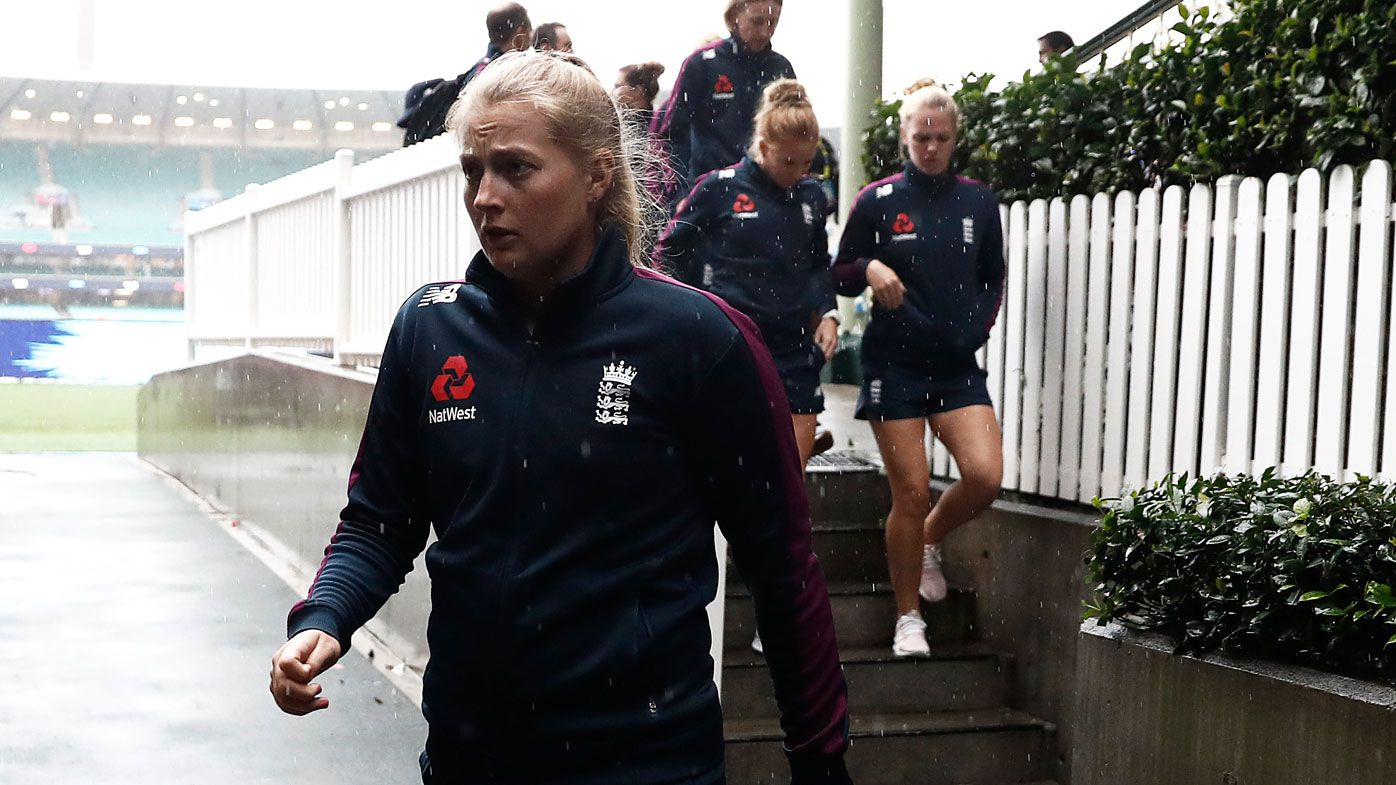 Sophie Ecclestone of England leaves the ground after the match was abandoned due to rain