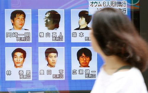 A street television screen in Tokyo showing six former AUM Shinrikyo cult members who were executed today. (Photo: AP).