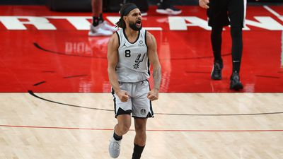 Patty Mills of the San Antonio Spurs celebrates in the fourth quarter against the Portland Trail Blazers.