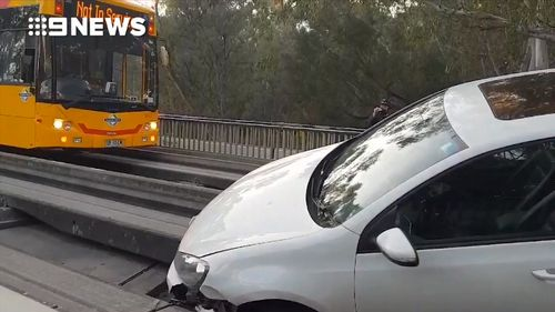 The hatchback blocked the tracks in both directions until it was removed around 8am.