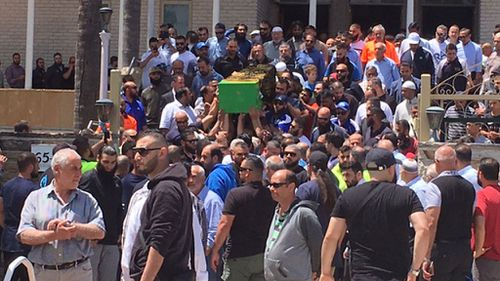 Hundreds of mourners followed the funeral procession into the mosque (Image: 9News/Damian Ryan)