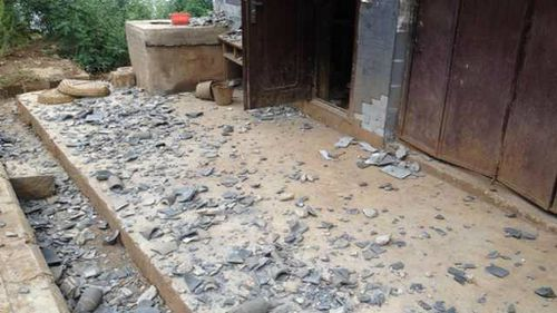 Broken tiles sit scattered on the ground after a 6.1 magnitude earthquake hit the area in Ludian county in Zhaotong, southwest China's Yunnan province on August 3, 2014. (Getty)