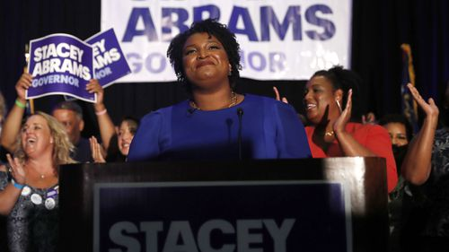 Stacey Abrams writes romance thrillers under a pseudonym. But she's on the verge of an upset in the Deep South state of Georgia.