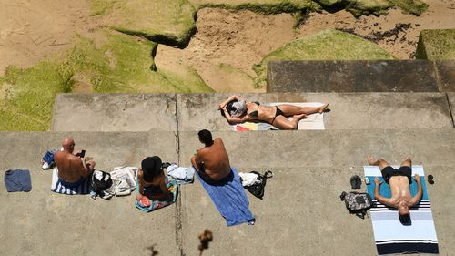 Beachgoers are warned to apply sunscreen and keep hydrated, avoiding the hottest part of the day if possible.