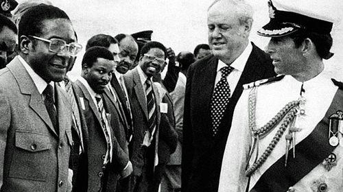 Prince Charles and Robert Mugabe during the British royal's visit to see the Zimbabwe peace transition in 1980. (Photo: AP).