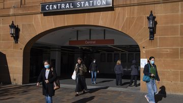 Commuters leaving Central station wearing masks in Sydney