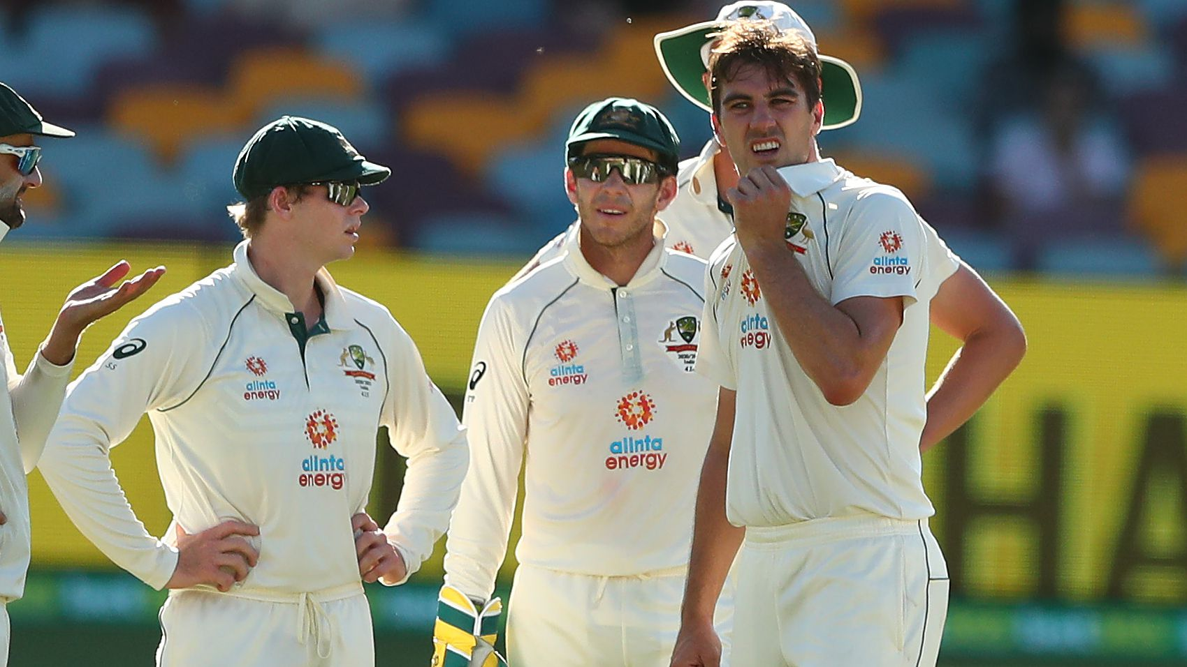 Australia players watch a review during a Test.