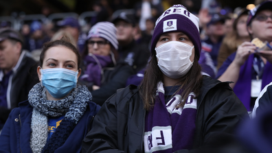 Spectators look on wearing face masks during the round 7 AFL match between the Fremantle Dockers and the West Coast Eagles at Optus Stadium on July 19, 2020 in Perth, Australia. (Photo by Paul Kane/Getty Images)