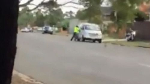 The motorbike rider appears to smash the window of the van. Picture: 9News