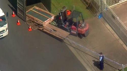 A pallet of glass panels fell onto the man, injuring him in the process.