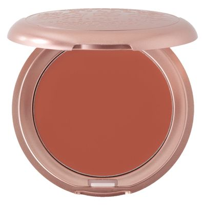 """Use just a little cream blush to add a natural flush to your face. Apply with your finger to the apples of your cheeks and blend up towards your temples for a brighter look. Cream is the best because it melts into your skin; I love Stila Convertible Colour in Peony for a great natural peach colour."""