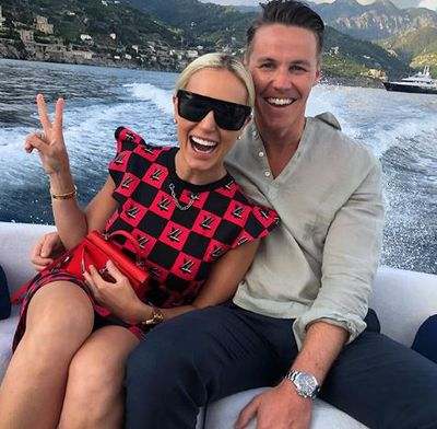 Roxy Jacenko in a Louis Vuitton mini dress and matching mini-clutch in Positano Italy