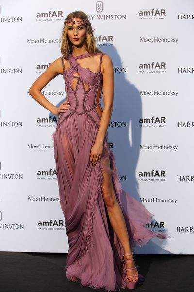 Karlie Kloss arrives for the AMFAR dinner, Sunday July 5 2015 in Paris, France.