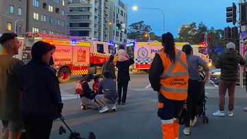 Sydney motorcyclist fighting for life after being hit by bus on city street