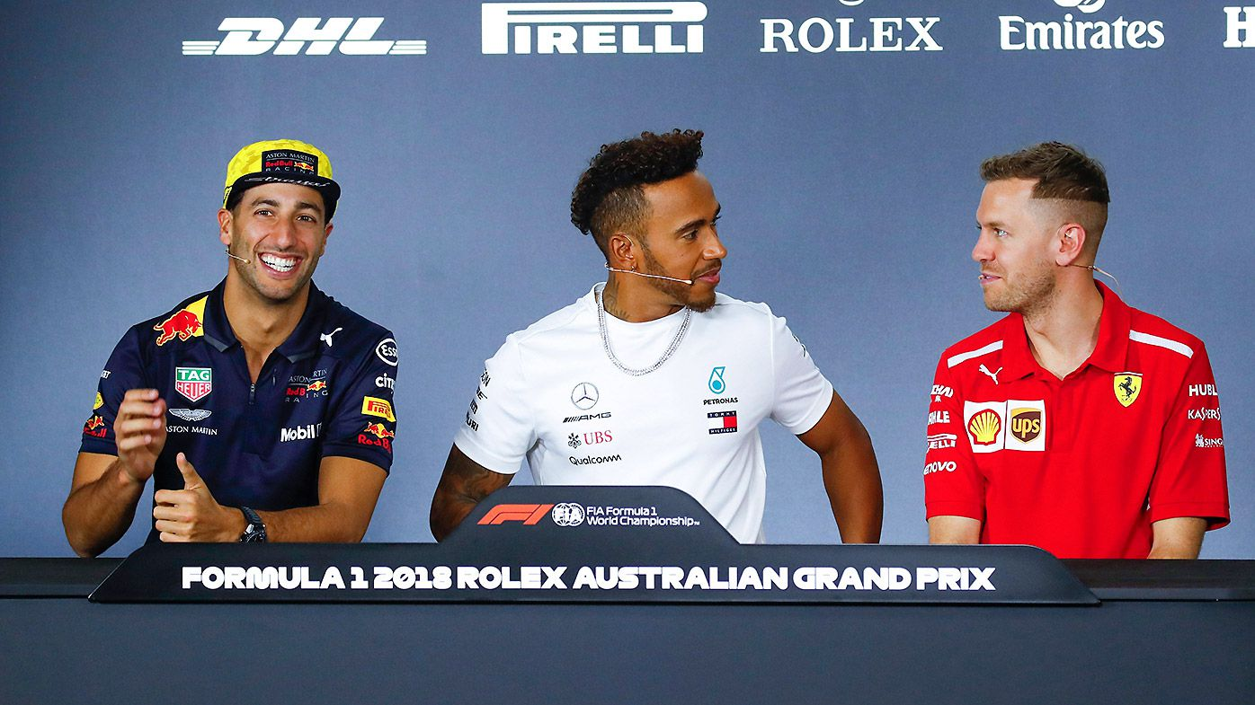 Australian Formula One driver Daniel Ricciardo of Aston Martin Red Bull Racing, British Formula One driver Lewis Hamilton of Mercedes AMG GP and German Formula One driver Sebastian Vettel of Scuderia Ferrari