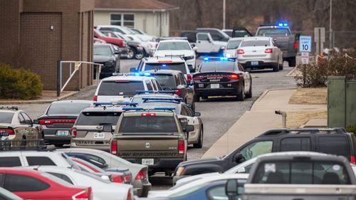 Authorities said a shooting suspect had been taken into custody. (AAP)
