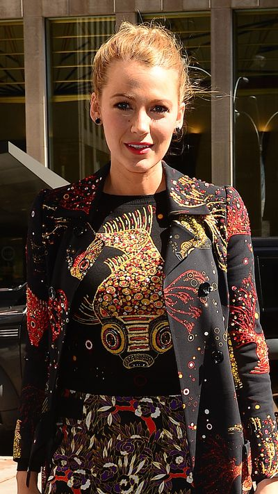 Proof that the messy bun can be worn with designer pieces.