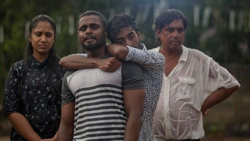 Mourners grieve at the burial of three members of the same family victims of Easter Sunday bomb blast at St. Sebastian Church in Negombo.
