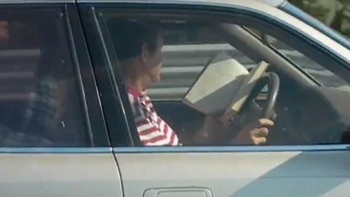 This driver actually decided reading a book would be a safe option
