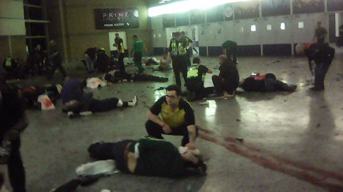 Helpers attend to injured people inside the Manchester Arena in 2017. (AAP)