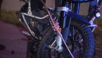 Perth motorcyclist crashes after downed power lines wrap around wheel