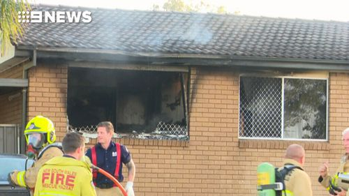 The mother ran back into the property several times to rescue the children surrounded by flames. (9NEWS)
