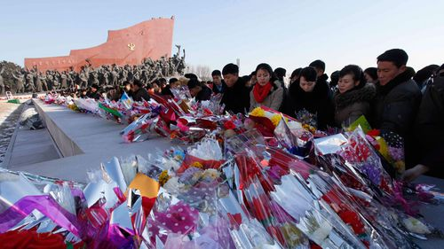 People offer flowers to the bronze statues of their late leaders Kim Il Sung and Kim Jong Il at Mansu Hill. (AP)