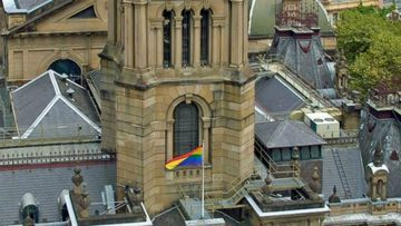 The rainbow flag at half mast at Sydney Town Hall. (CloverMoore)