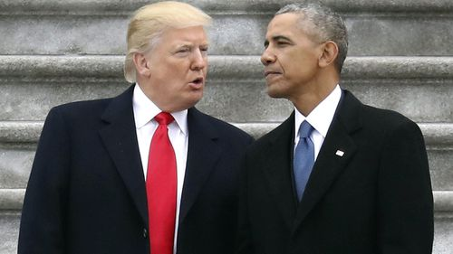 President Donald Trump talks with former President Barack Obama on Capitol Hill in Washington in January 2017.