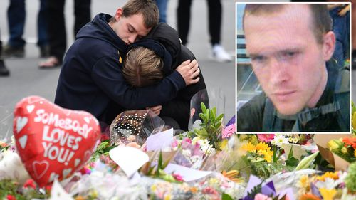 Members of the public mourn at a flower memorial and Brenton Tarrant