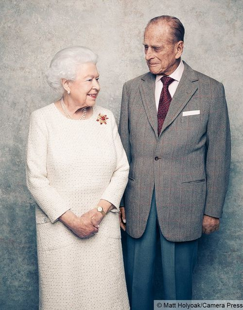 Queen Elizabeth and Prince Philip pose up for a photograph to mark their 70th wedding anniversary. (Matt Holyoak/Camera Press)