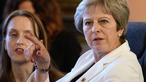 May warns of PM Corbyn amid resignations