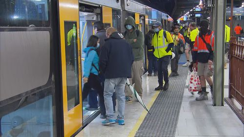 Sydney's Central Station saw commuters return, with services almost back to normal. Face masks are mandatory on board and at stations.