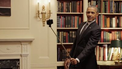 The much-derided selfie stick seemed to capture his attention, as he struck a number of poses.
