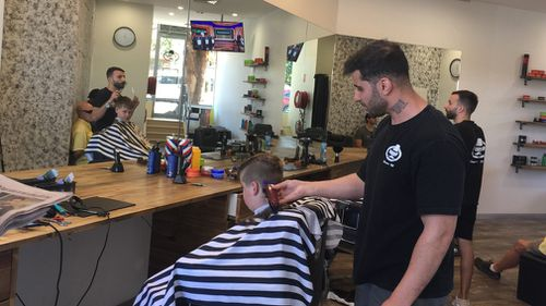 Sydney barber Sam Rahim will face the Human Rights and Equal Opportunity Commission after refusing to cut a young girl's hair. Picture: 9NEWS.