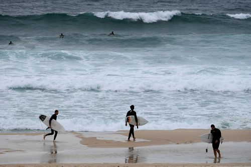 Currently, only soft-topped surfboards are allowed to be used anywhere on the beach, while hard-topped boards are restricted to the south. Picture: AAP.