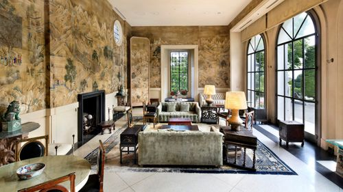 The mansion is spread across four-levels with a ballroom, library with fireplace and a concealed bar.