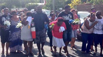 Family members arrive at the Manoora shrine in Cairns. (Tom Steinfort)