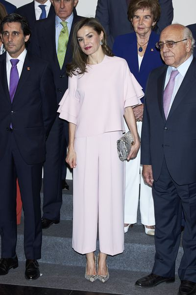 <p>In May 2017, the Spanish Queen chose to keep it neutral and budget-friendly in this head-to-toe blush pink ensemble from Zara. </p> <p>Letizia added snake-print accessories: a clutch from Lidia Faro and a pair of pumps from Magrit to give the outfit an edgy finish.</p>