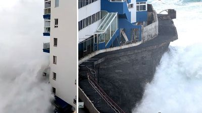 Giant wave in Tenerife smashes into apartment block